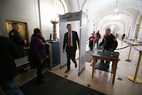 Cincinnati City Council member P.G. Sittenfeld passes through security ahead of a hearing for a proposed settlement in the lawsuit involving secret texts and email by members of Cincinnati City Council, Thursday, March 7, 2019, at the Hamilton County Courthouse in Cincinnati.