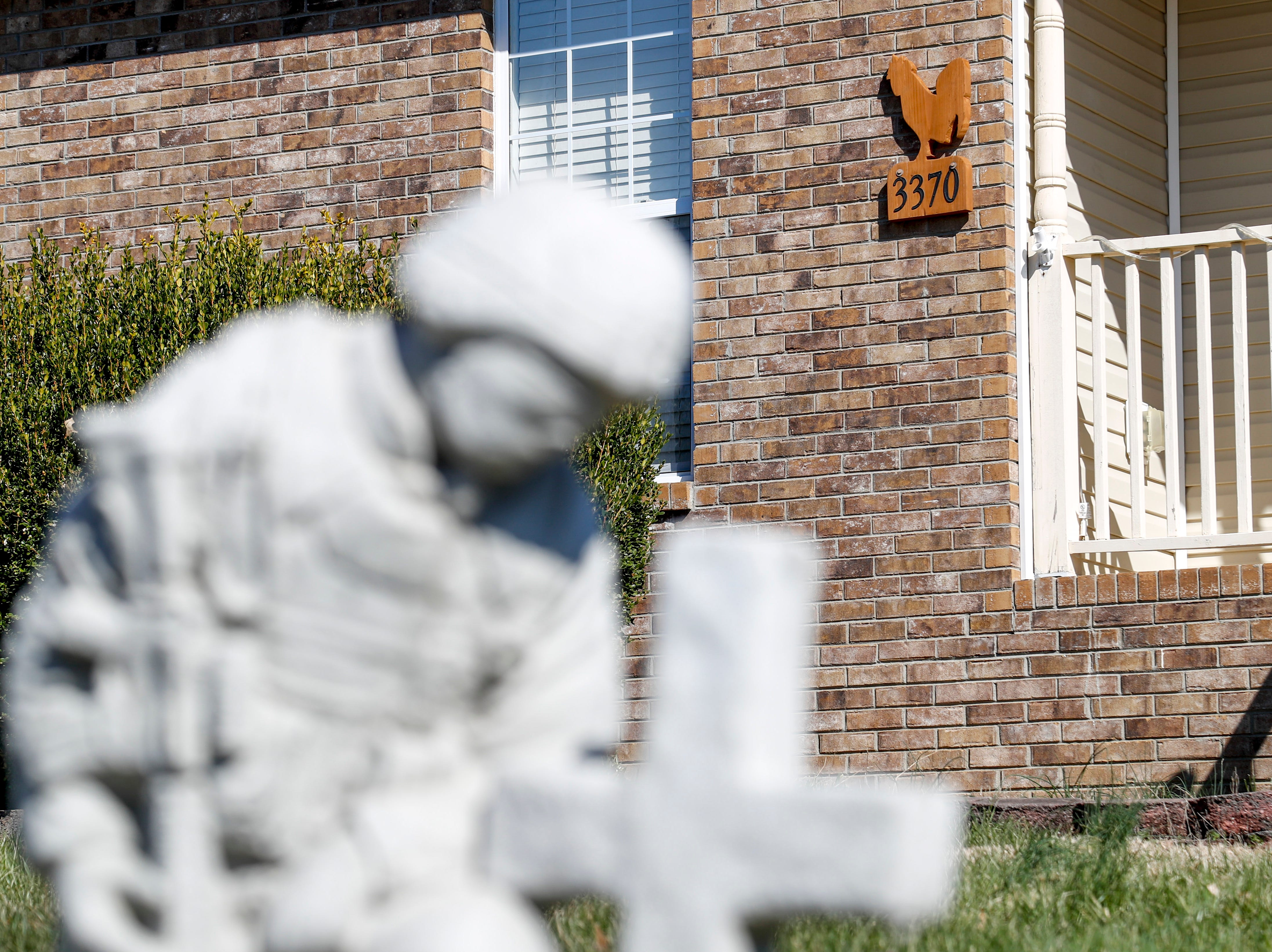 A statue of a soldier rests in the front yard of Heath Stamper and Shawna Lund's home in Clarksville, Tenn., on Wednesday, March 6, 2019.