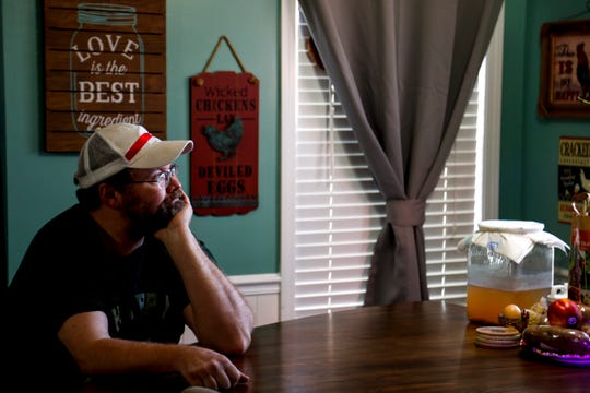 Heath Stamper sits at their kitchen table and gazes outside he and his partner Shawna Lund's home in Clarksville, Tenn., on Wednesday, March 6, 2019.
