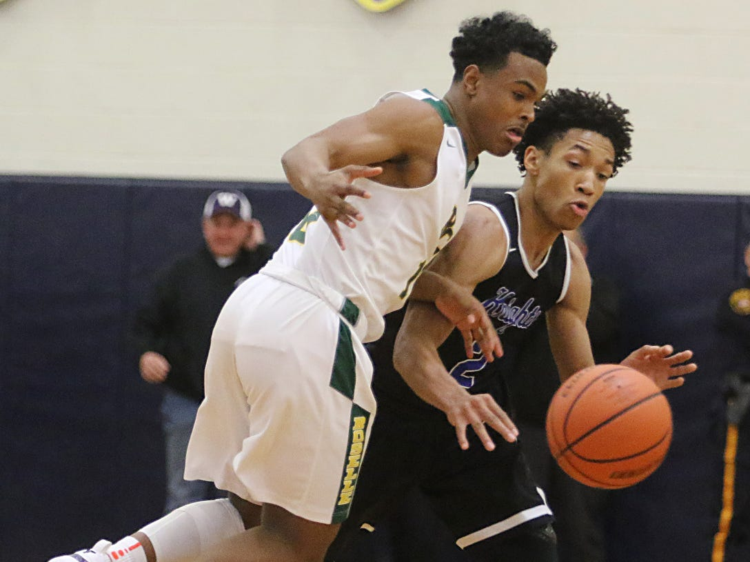 Corey Floyd Jr. Of Roselle Catholic goes for the ball with Kahlil Whitney of GSB in the fourth quarter.
