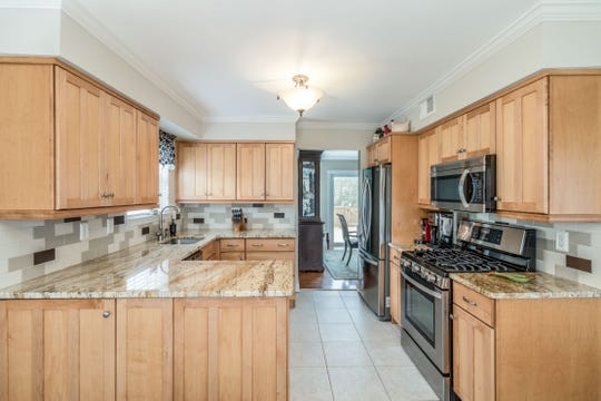 Situated in a Branchburg neighborhood, a recently renovated half duplex Colonial that is sited on an open, level lot across the street from a community park is for sale for $415,000.