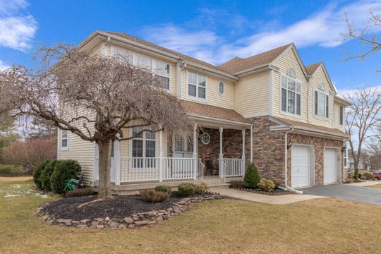 Situated in a Branchburg neighborhood, a recently renovated half duplex Colonial that issited on an open, level lot across the street from a community park is for sale for$415,000.