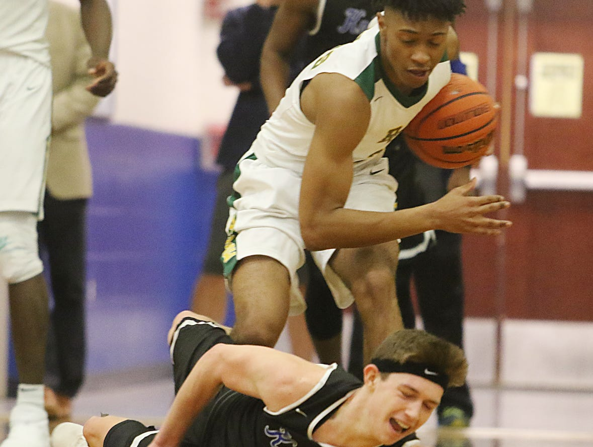 Colby Rogers of Roselle Catholic gets the ball overt a fallen Paul Mulcahy of GSB.