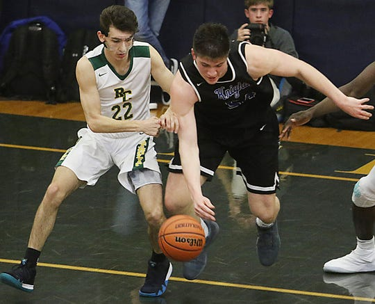 Richie Greaves of Roselle Catholic goes for the ball with Zach Martini of GSB in the first half.