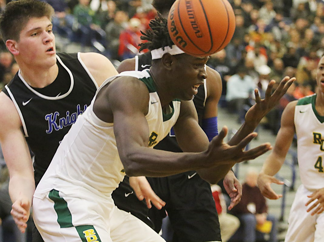 Zach Martini of GSB and Cliff Omoyuri of Roselle Catholic go for the rebound.