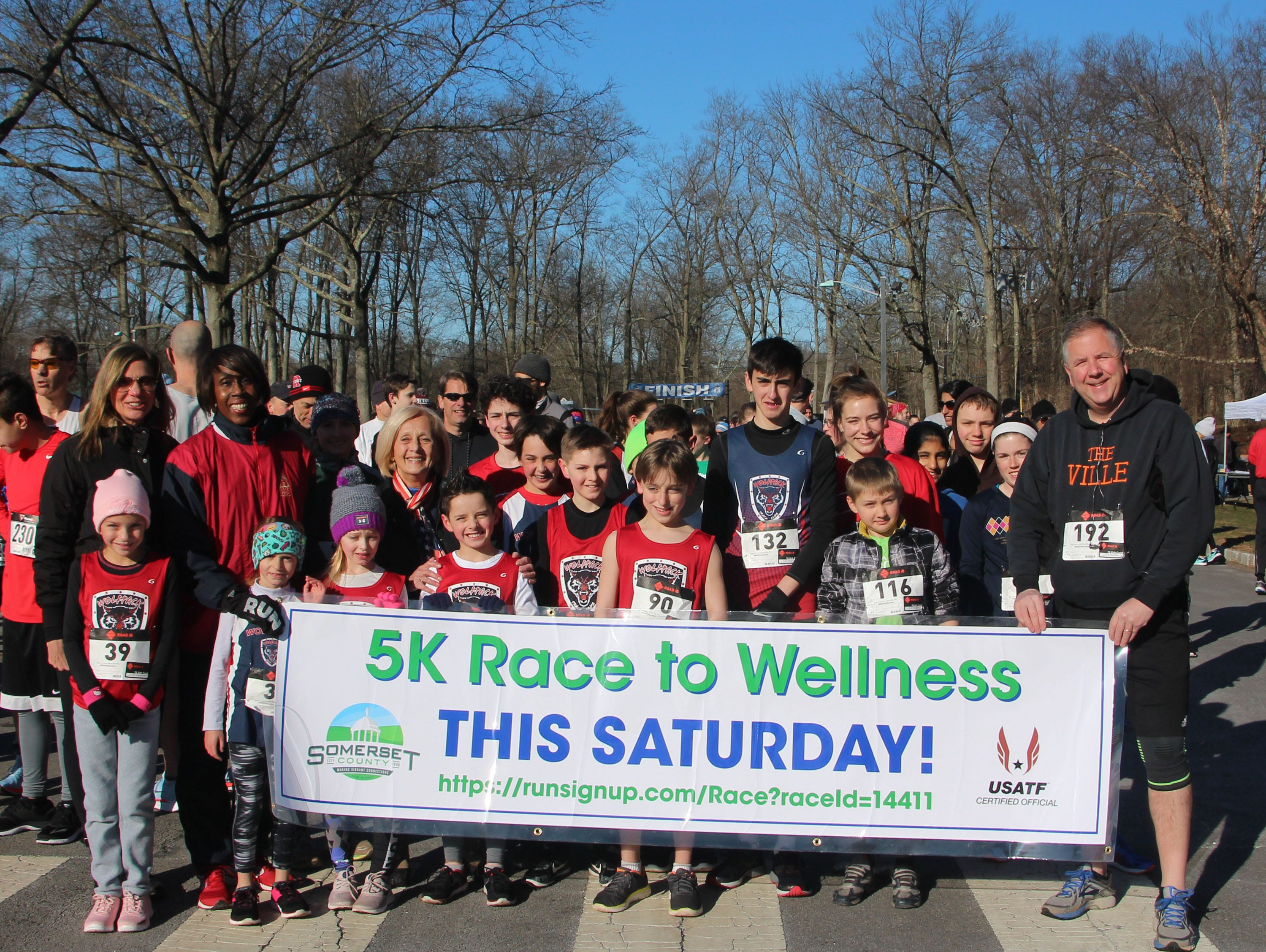 In 2018, Joetta Clark Diggs, Freeholder Deputy Director Patricia L. Walsh and Freeholder Brian G. Gallagher gathered  participants for a group photo before tackling the course at the annual 5K Race to Wellness.