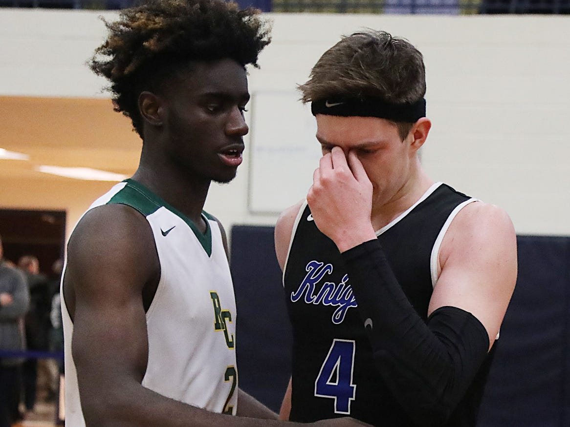 Khalil Whitney of Roselle Catholic and Paul Mulcahy of GSB get together at the end of a hard fought game that ended with a close 48-44 win by Roselle Catholic.