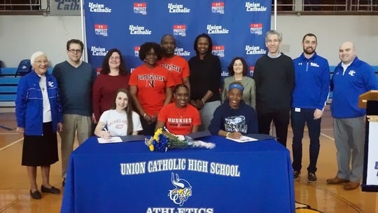 From left to right-Union Catholic track and field stars Hope Handlin, Khamil Evans, and Jerika Lufrano signed their National letters of intent.