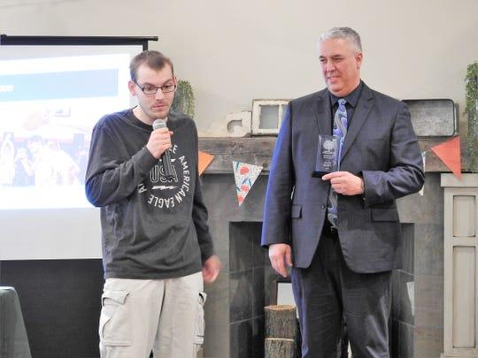 Jalen Berry receives the Individual Spotlight Award from Steve Oster, DD Superintendent, at a recent awareness luncheon.