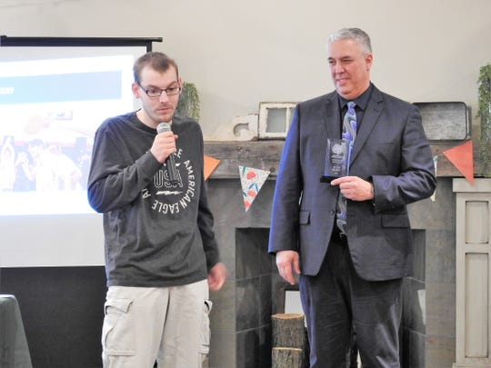 Jalen Berry receives the Individual Spotlight Award from Steve Oster, DD Superintendent, at a recent awareness luncheon.