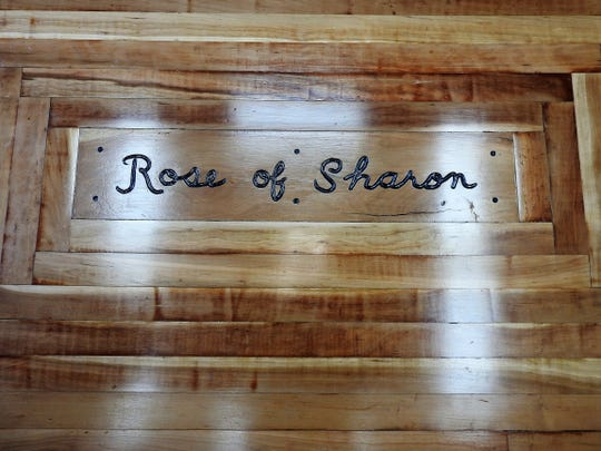 Re-purposed flooring from the Coshocton Church of the Nazarene was recently installed in the Rose of Sharon Retreat with lettering done by Tim Borne.
