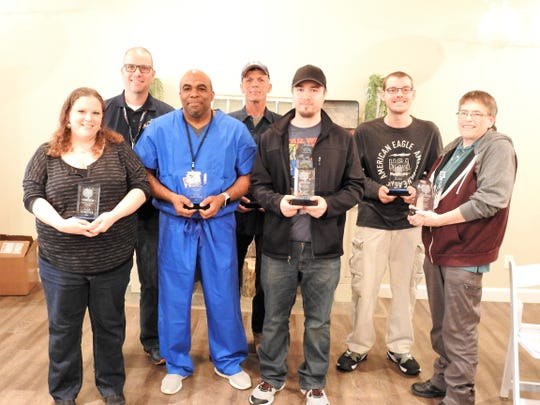Several individuals received awards at a recent Developmental Disabilities Awareness Month luncheon. Nominations came from various people and were reviewed by a committee.