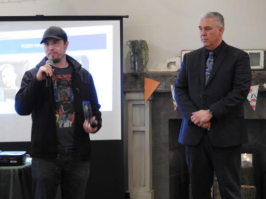 Todd Walker receives the Individual Spotlight Award from Steve Oster, DD Superintendent, at a recent awareness luncheon.