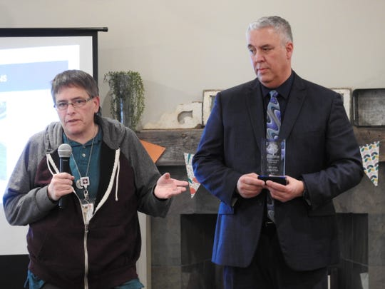 Wilma Griffith of Family Physicians receives the Community Partner Award from Steve Oster, DD Superintendent, at a recent DD Awareness Month lunch.