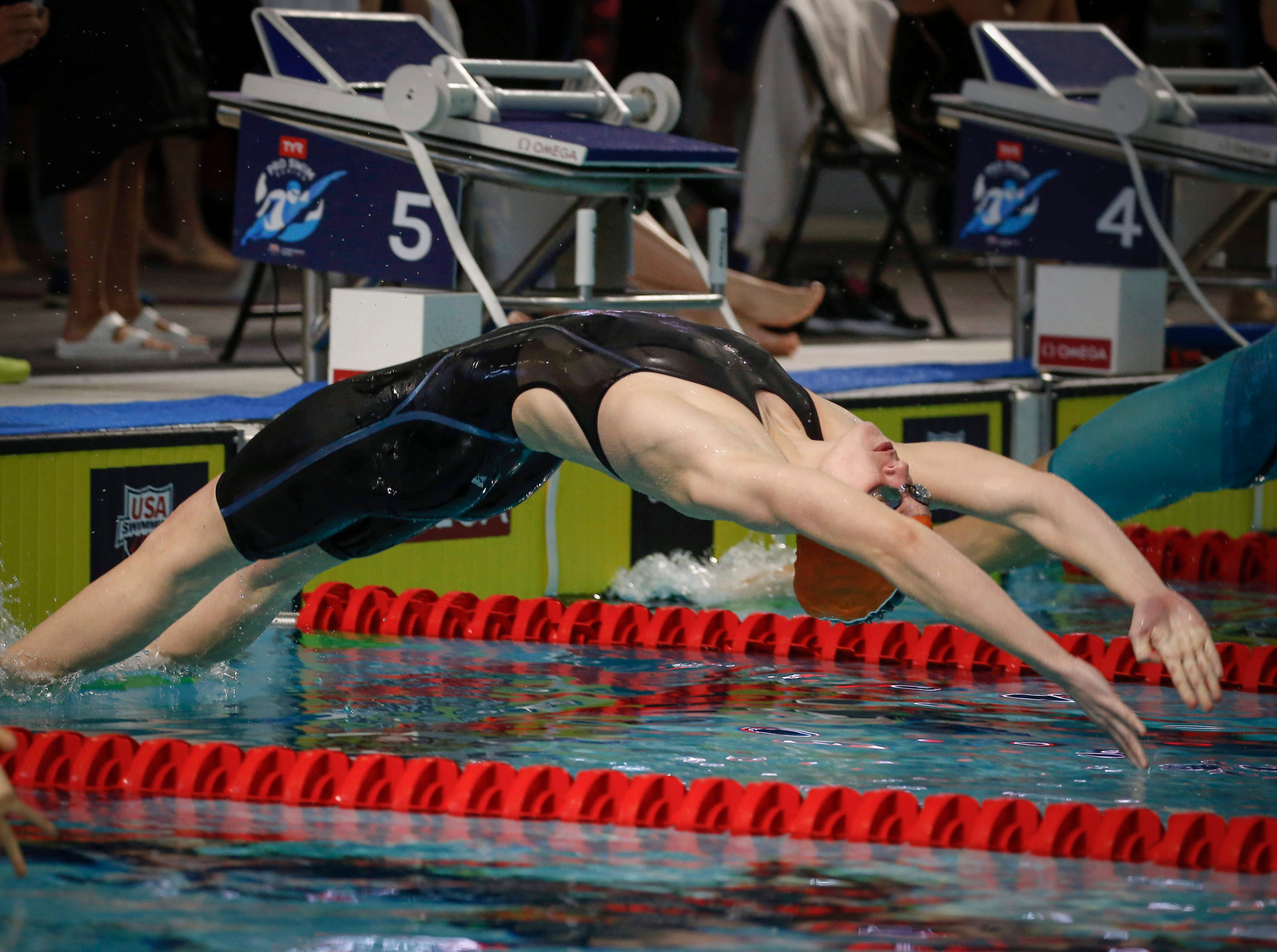 Amy Feddersen of Ames and a future University of Missouri swimmer explodes off the starting block in the 50-meter backstroke during the 2019 TYR Pro Swim Series on Thursday, March 7, 2019, at the downtown YMCA pool in Des Moines.