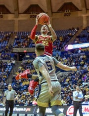 Iowa State guard Tyrese Haliburton (22) shoots over West Virginia guard Jordan McCabe (5) during the second half of an NCAA college basketball game Wednesday, March 6, 2019, in Morgantown, W.Va.