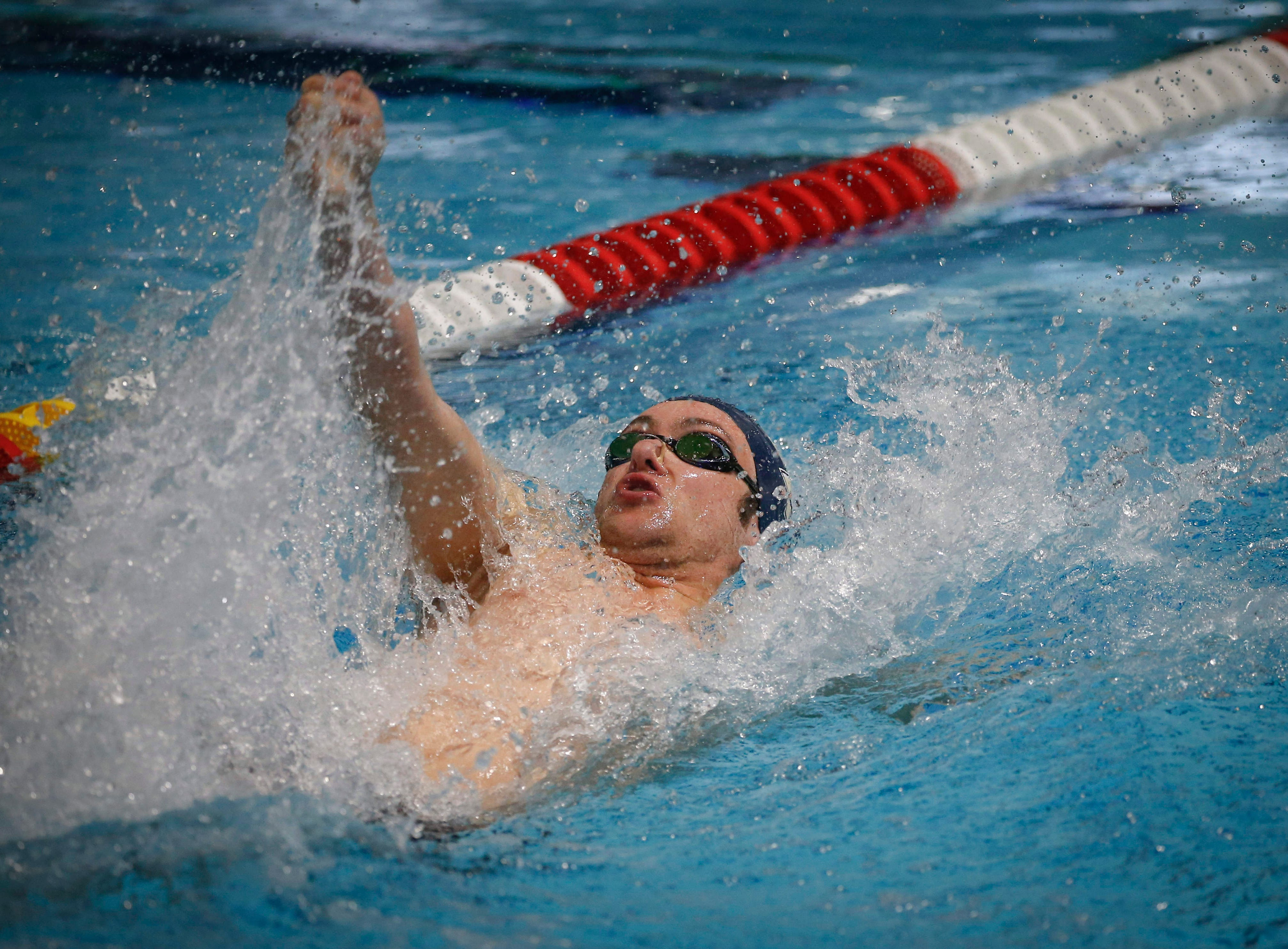 Ryan Patterson of Omaha and a swimmer at George Washington University, competes in the 50-meter backstroke during the 2019 TYR Pro Swim Series on Thursday, March 7, 2019, at the downtown YMCA pool in Des Moines.