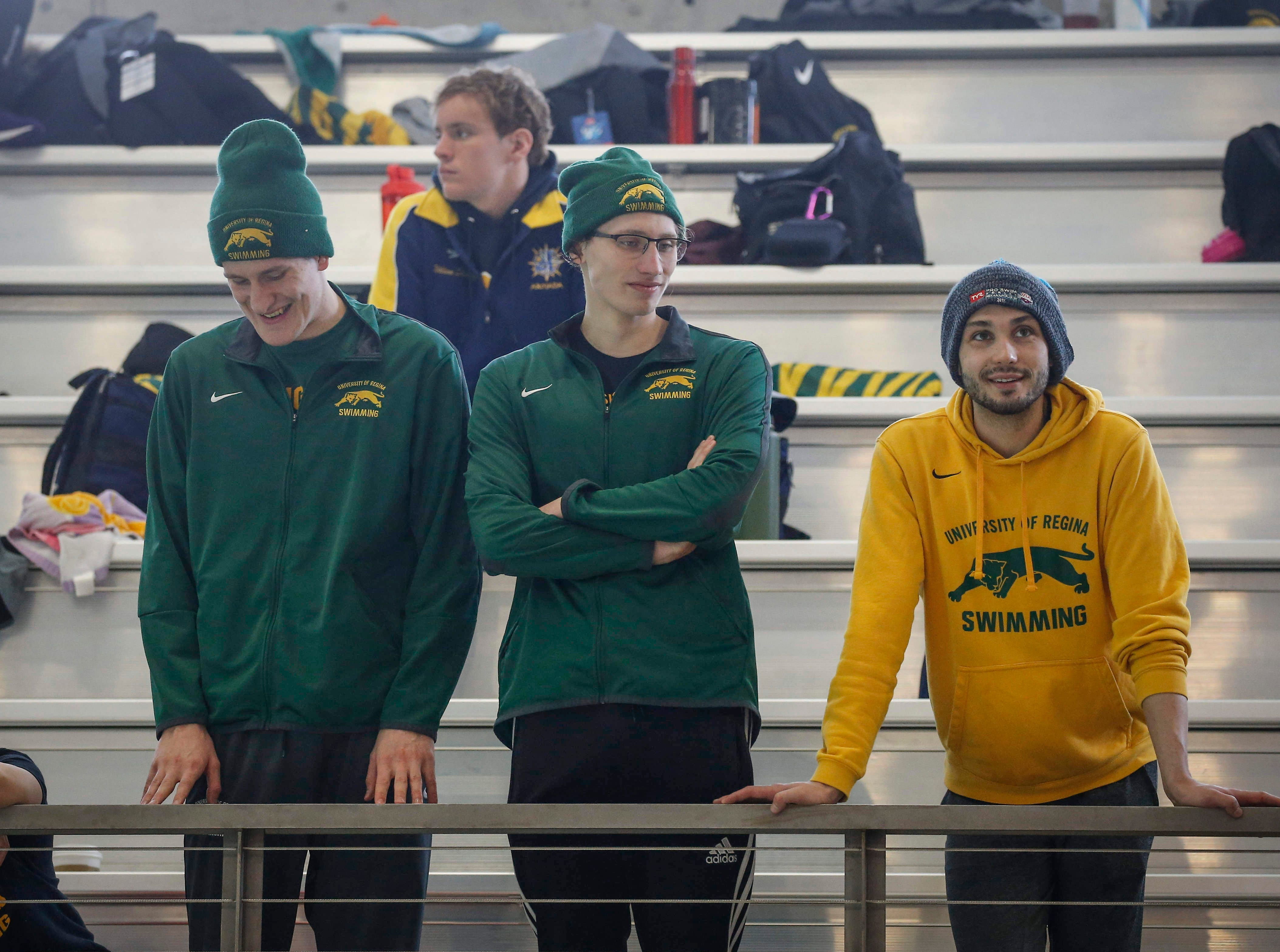 Swimmers from the University of Regina in Regina, Saskatchewan, watch the action in the pool during the 2019 TYR Pro Swim Series on Thursday, March 7, 2019, at the downtown YMCA pool in Des Moines.