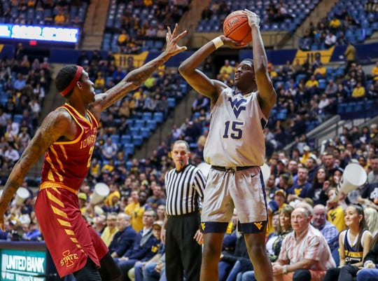 Mar 6, 2019; Morgantown, WV, USA; West Virginia Mountaineers forward Lamont West (15) shoots during the second half against the Iowa State Cyclones at WVU Coliseum.