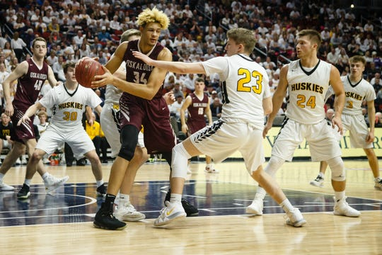 Oskaloosa's Xavier Foster (34) looks for a pass during their boys 3A state semi-final basketball tournament game on Thursday, March 7, 2019 in Des Moines. Oskaloosa and Winterset take a 28-28 tie into halftime.