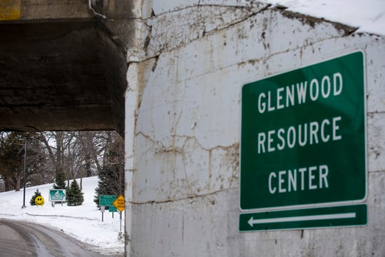 Signs mark the entrance to the Glenwood Resource Center, one of two facilities like it in Iowa providing care for people with 