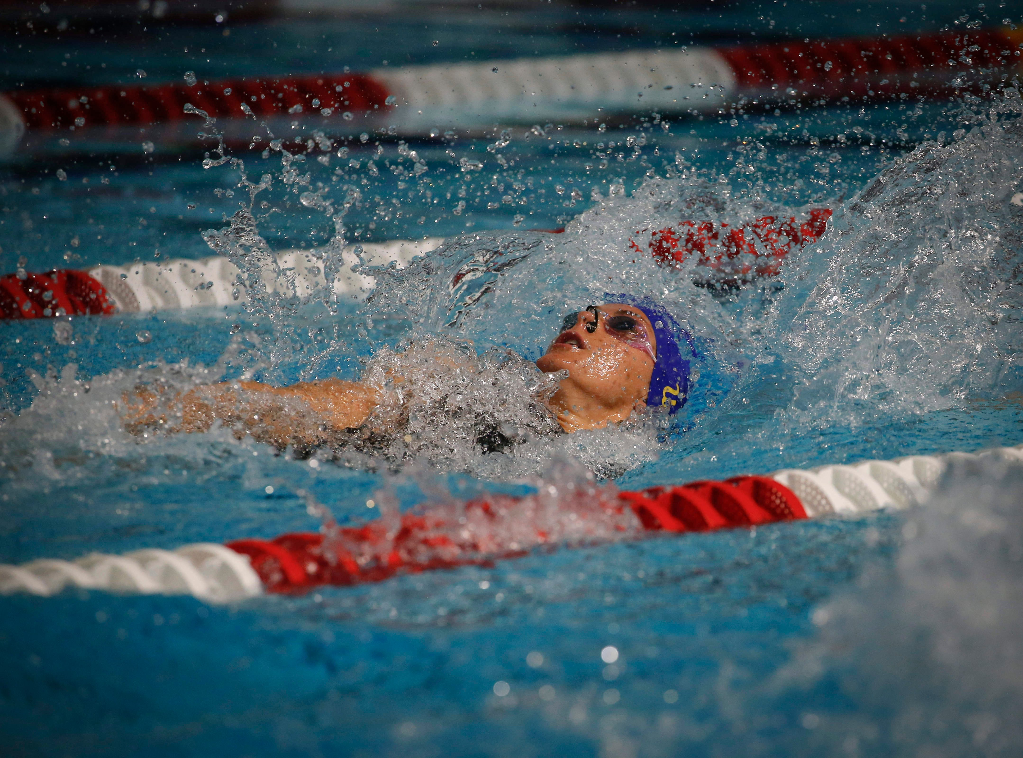 Linnea Mack of San Jose, Calif., and a swimmer at UCLA, competes in the 50-meter backstroke during the 2019 TYR Pro Swim Series on Thursday, March 7, 2019, at the downtown YMCA pool in Des Moines.