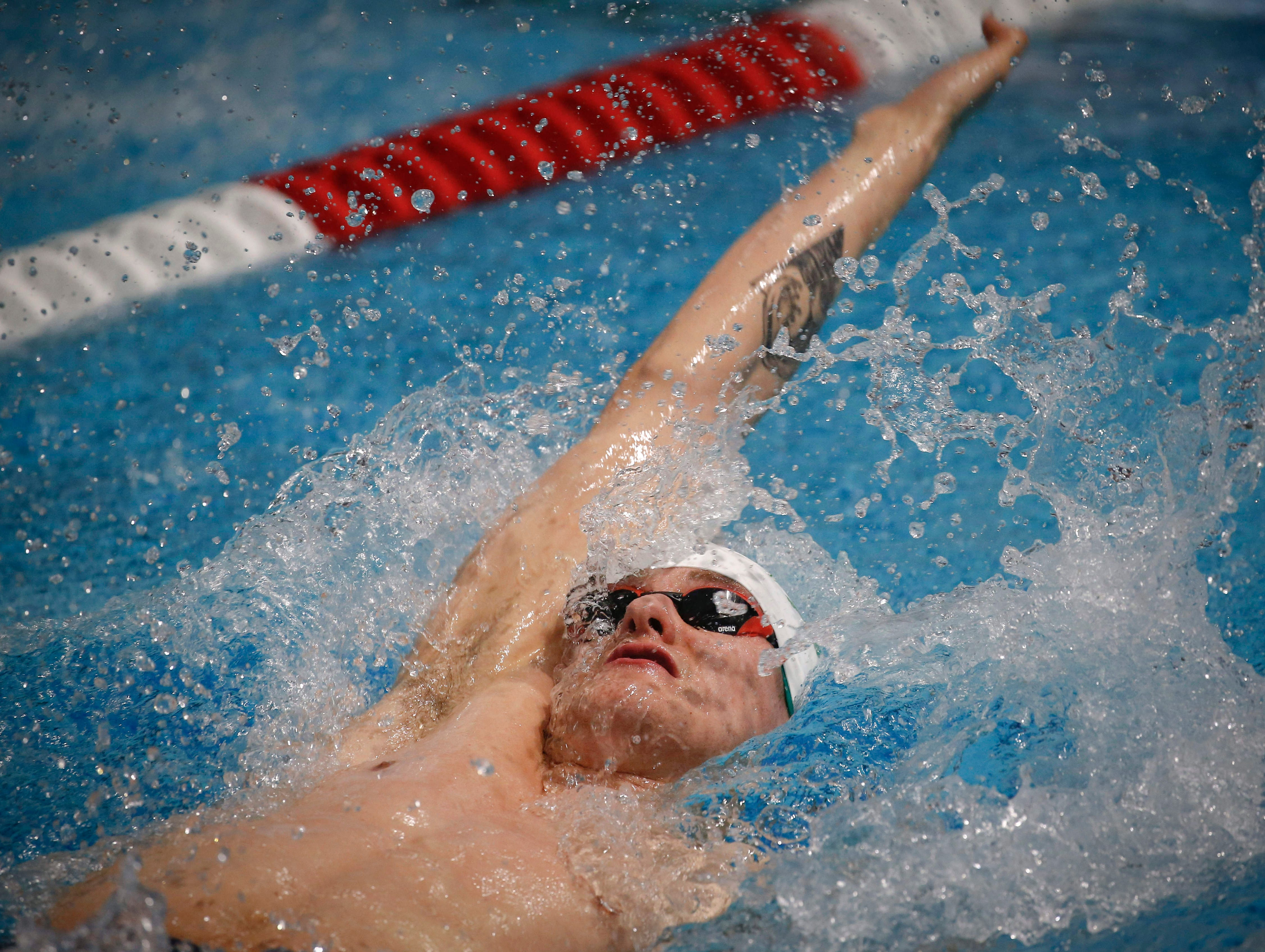 Noah Wasyliw of Winnipeg, Manitoba, competes in the 50-meter backstroke during the 2019 TYR Pro Swim Series on Thursday, March 7, 2019, at the downtown YMCA pool in Des Moines.