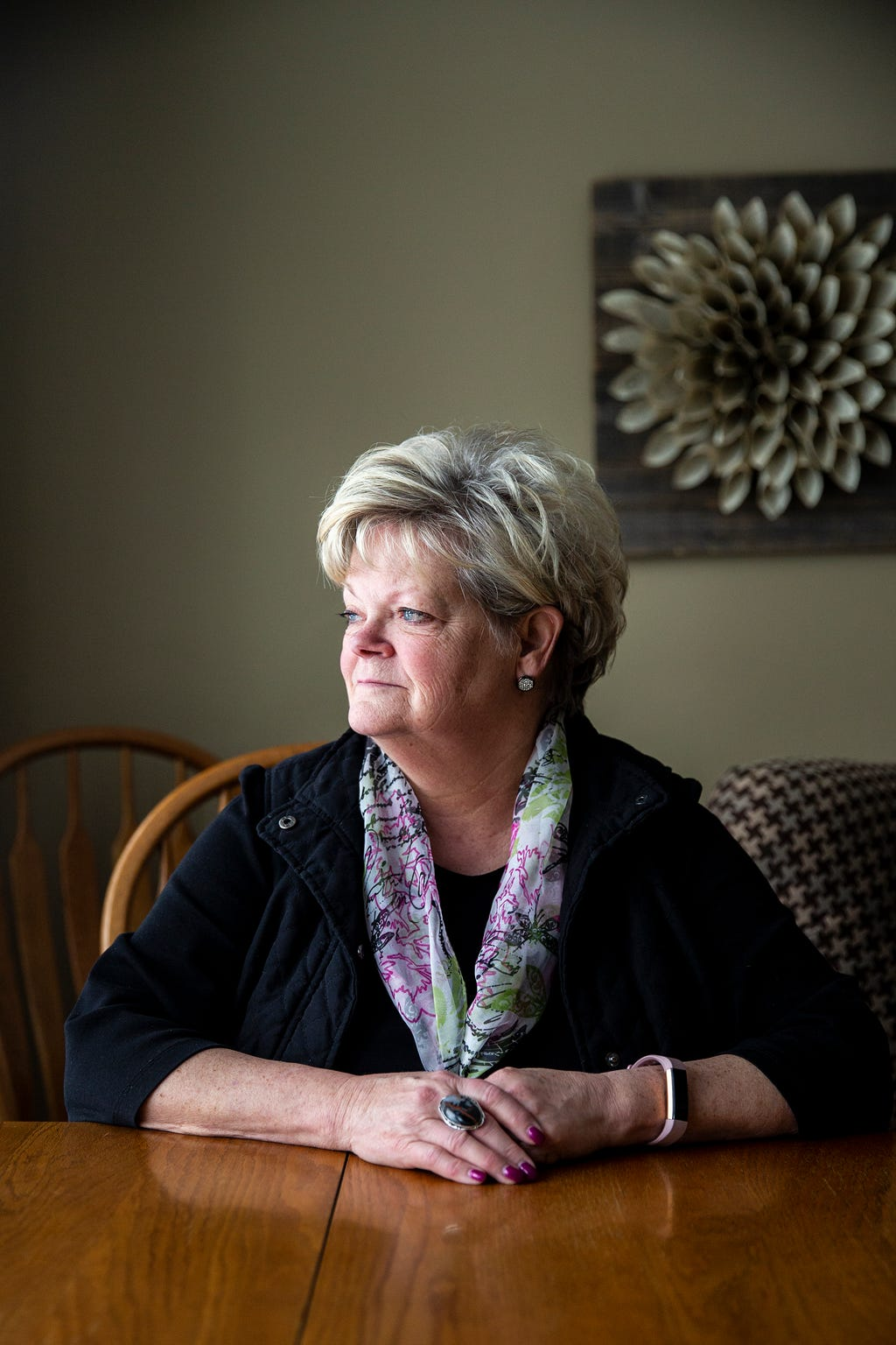 Kathy King looks out the window of her home on Thursday, March 7, 2019, in Glenwood. King worked at the Glenwood Resource Center for 43 years, most recently as a treatment program administrator. The resource center is one of two facilities in Iowa serving people with  intellectual disabilities, many who require constant and continuous medial supervision. King is now a guardian for two residents and has become concerned with the changes made over the last year to the resource center's medical services.