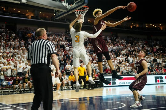 Oskaloosa's Xavier Foster (34) swats away the go-ahead shot with seconds left from Winterset's Easton Darling (3) during their boys 3A state semi-final basketball tournament game on Thursday, March 7, 2019 in Des Moines. Oskaloosa would go on to defeat Winterset 48-43.