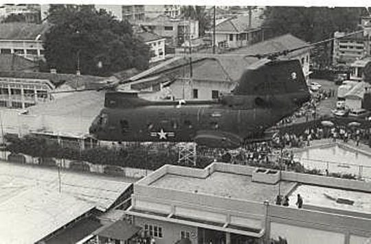 This United States Marines photo of Gerry Berry in his Boeing Vertol CH-46 on the day of the Saigon evacuation, April 29, 1975, shows some of the crowds trying to leave the city.