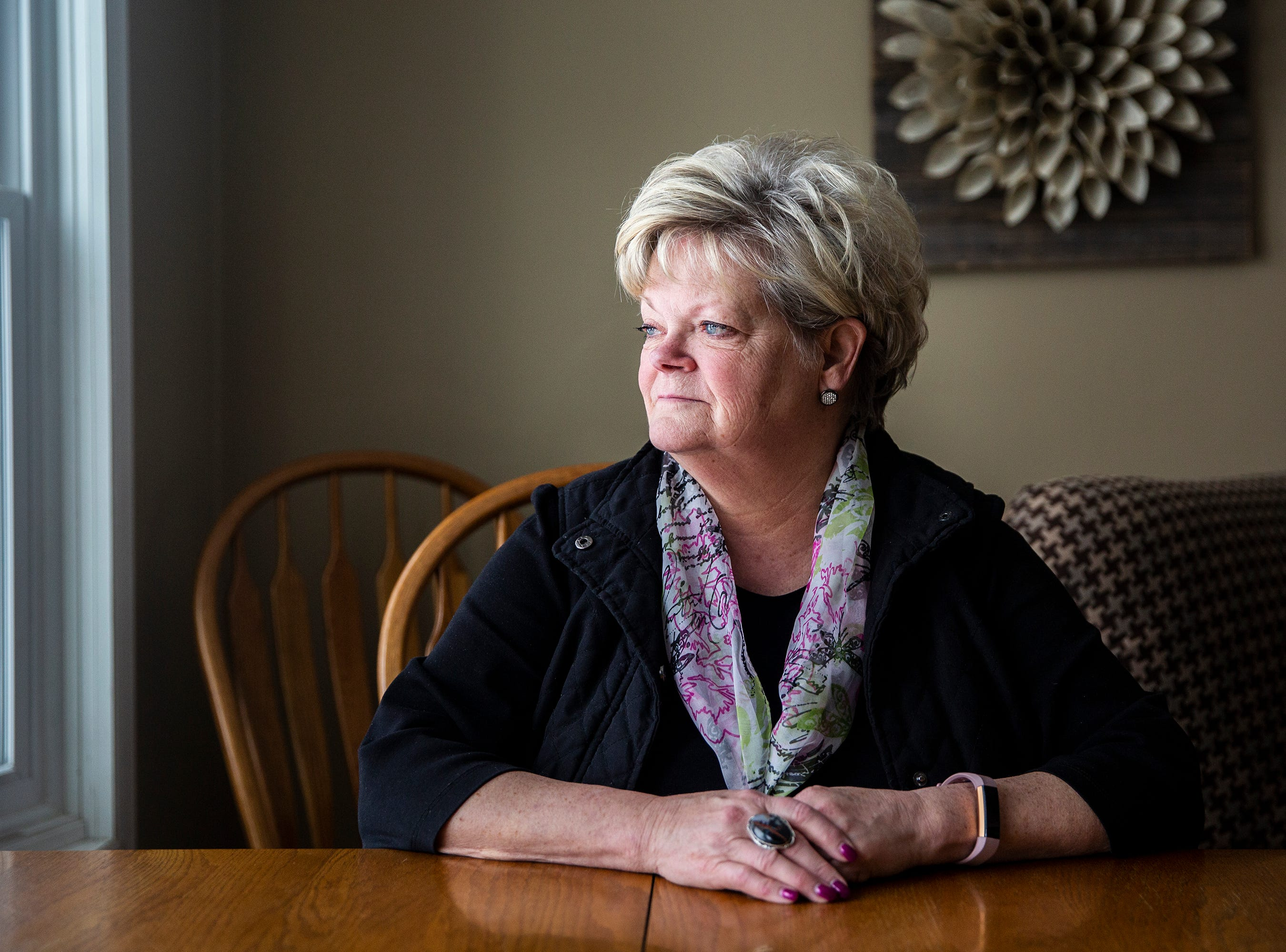 Kathy King looks out the window of her home on Thursday, March 7, 2019, in Glenwood. King worked at the Glenwood Resource Center for 43 years, most recently as a treatment program administrator. The resource center is one of two facilities in Iowa serving people with 