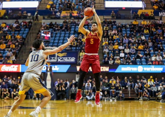 Mar 6, 2019; Morgantown, WV, USA; Iowa State Cyclones guard Lindell Wigginton (5) shoots the ball during the first half against the West Virginia Mountaineers at WVU Coliseum.