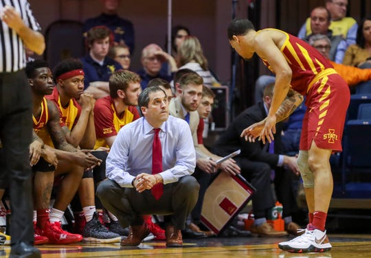 Mar 6, 2019; Morgantown, WV, USA; Iowa State Cyclones head coach Steve Prohm (center) talks with Iowa State Cyclones guard Nick Weiler-Babb (1) during the first half against the West Virginia Mountaineers at WVU Coliseum.