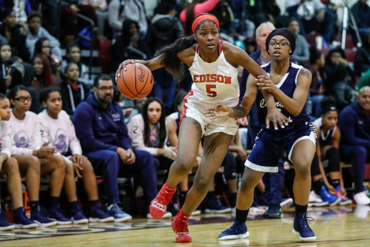 Detroit Edison's Rickea Jackson (5) dribbles against Chandler Park's Anaya Kennedy (5) during the first half of the district semifinal at Harper Woods High School in Harper Woods, Wednesday, March 6, 2019.