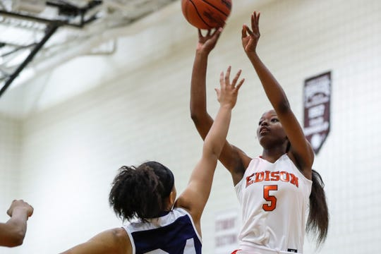 Detroit Edison's Rickea Jackson (5) makes a jump shot against Chandler Park during the first half of the district semifinal at Harper Woods High School in Harper Woods, Wednesday, March 6, 2019.
