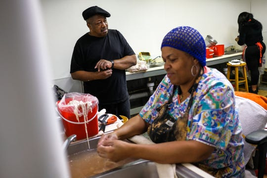 "Chuck Sims, 70, takes a break from cleaning hog maws, as Lynn Davis, 64, cleans chitlins in a sink at Gourmet Food Center on Detroit's west side on Feb. 7, 2019. ""Back in the day you couldn't skin no chitlins, 'cause you got in trouble,"" Davis said. ""They said that was all meat, that skin made them a thicker pot."""