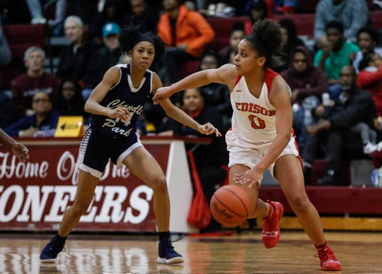 Detroit Edison's Damiya Hagmann (0) dribbles against Chandler Park during the first half of the district semifinal at Harper Woods High School in Harper Woods, Wednesday, March 6, 2019.