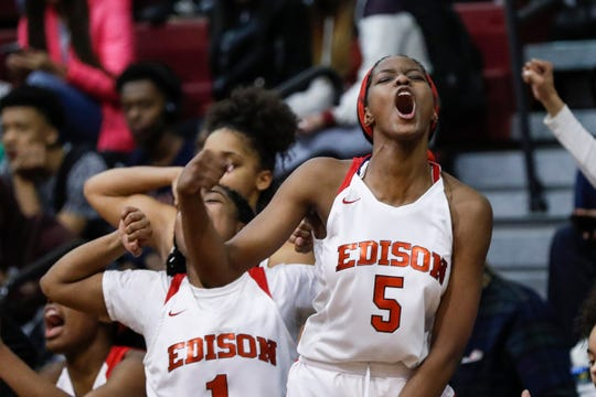 Detroit Edison's Rickea Jackson (5) and Daija Tyson (1) cheer for teammates during the second half of the district semifinal against Chandler Park at Harper Woods High School in Harper Woods, Wednesday, March 6, 2019.