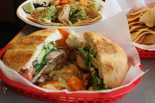 Chela's Restaurant & Taqueria in Ann Arbor uses only fresh produce and meats, prepared daily, and makes all its food in-house. Shown are a Cubana torta (sandwich), a lunch-special plate and a basket of chips.