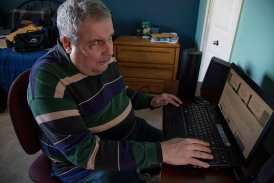 Mike Powell, 65, demonstrates some accessibility issues websites have for navigating for the visually impaired.