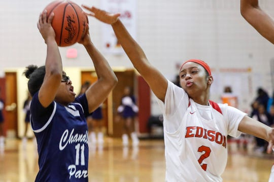 Detroit Edison's Ruby Whitehorn (2) tries to block a shot from Chandler Park's Emaia O'Brien (11) during the first half of the district semifinal at Harper Woods High School in Harper Woods, Wednesday, March 6, 2019.