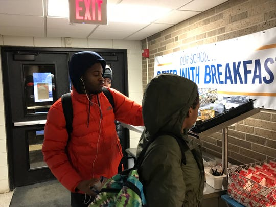 Students entering the Southfield Regional Academic Campus grab the free breakfast just after 7 am Thursday, as part of the Better With Breakfast program being expanded from a handful of schools to more than 70 across the county in the next three years.