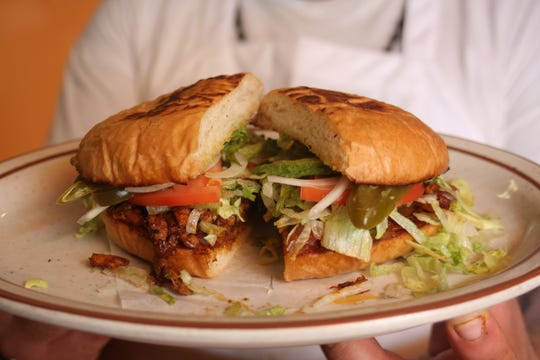 The Torta Al Pastor at Taqueria Lupita's in Detroit's Mexicantown is made with grilled marinated pork and the restaurant's spicy-sweet house-made sauce.  Then it's layered onto a toasted bun with lettuce, tomato, onion, avocado and jalapenos