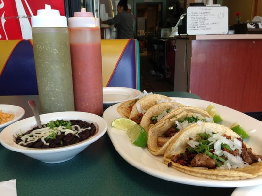 Menu items at Tmaz Taqueria in Ann Arbor.