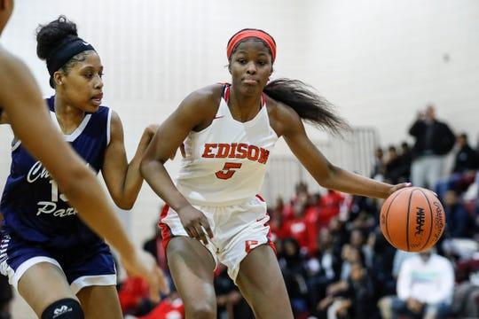 Detroit Edison's Rickea Jackson (5) dribbles against Chandler Park India Respress (15) during the first half of the district semifinal at Harper Woods High School in Harper Woods, Wednesday, March 6, 2019.