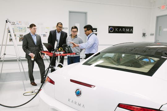 In Karma's the inside of our Detroit Technical Center in Troy: Eric Keipper, Karma director of vehicle integration; Darren Post, vice president, DTC and Revero chief engineer; Dr. Lance Zhou, CEO; and Vino Pathmanathan,  powertrain systems technical specialist.