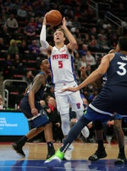 Detroit Pistons guard Luke Kennard scores against Minnesota Timberwolves guard Jeff Teague during first period action Wednesday, March 6, 2019 at Little Caesars Arena in Detroit, Mich.