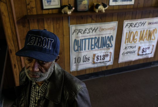 "Bennie Ross, 66, of Detroit waits for his order of hand-cleaned chitlins at Gourmet Food Center on Detroit's west side on Thursday, Feb. 7, 2019. ""Most young people I know don't eat 'em, like my kids don't eat 'em, so I know they probably don't introduce chitlins to their kids,"" Ross said."