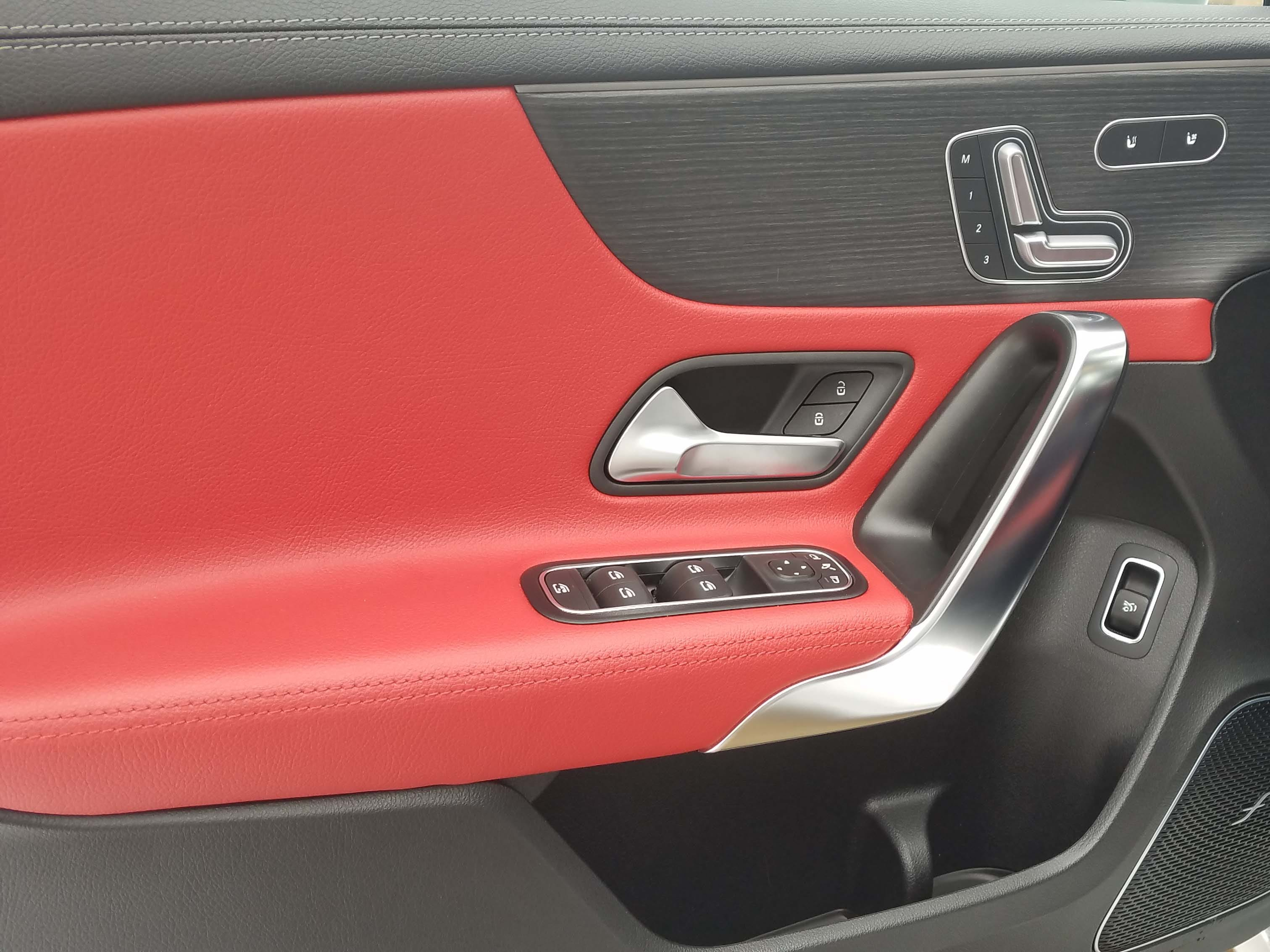 The door of the Mercedes A220 offers familiar Mercedes touches like seat adjustment and stylish design.