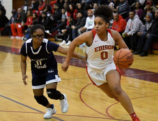 Chandler Park's Emaia O'Brien (11) chases Detroit Edison's Damiya Hagemann (0) in the first half.